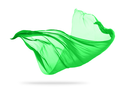 Flying piece of colored cloth texture isolated on white
