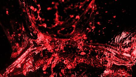 Abstract red wine splash shape on black background. Bavaragers and drink graphic element