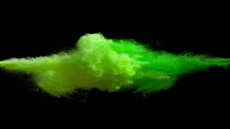 Collision of colored powder isolated on black background. Abstract colored background