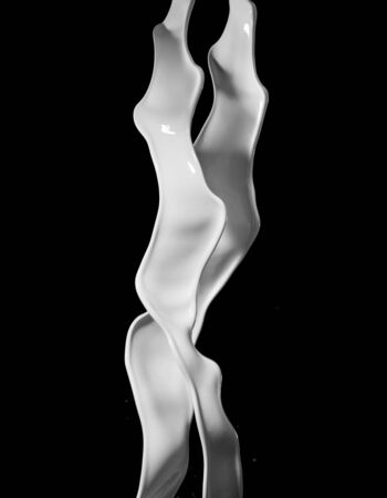 Milk splashes isolated on black background. Abstract shape in rotation. 스톡 콘텐츠