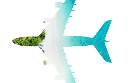 Travel concept of airplane silhouette with tropical beach. Beach holiday and airplane transportation conceptual image 写真素材