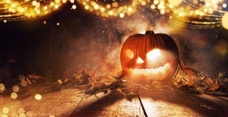 Spooky halloween pumpkin on wooden planks in dark cellar. Celebration theme, copyspace for text. Very high resolution image Zdjęcie Seryjne