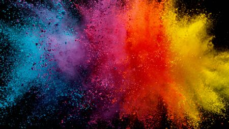 Explosion of colored powder isolated on black Zdjęcie Seryjne