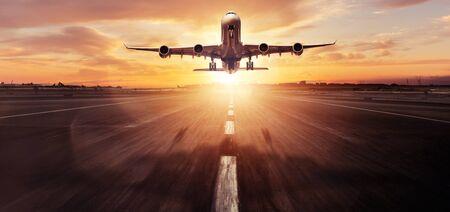 Huge two storeys commercial jetliner taking off. Modern and fastest mode of transportation. Dramatic sunset sky on background