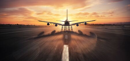 Huge two storeys commercial jetliner taking off runway. Modern and fastest mode of transportation. Dramatic sunset sky on background
