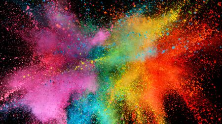Explosion of colored powder isolated on black 스톡 콘텐츠