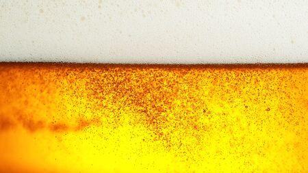 Detail of beer drink with foam head, super macro shot 写真素材