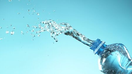 Exploding fresh water from plastic bottle on soft blue