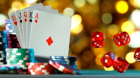 Poker still life with rolling gaming dices. Concept of hazard gaming, free space for text.