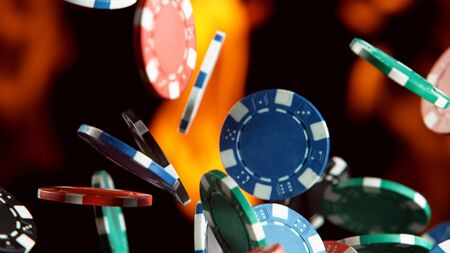 Falling poker chips with flames Isolated on black