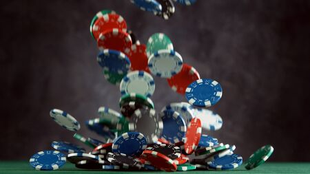 Poker still life with falling poker chips