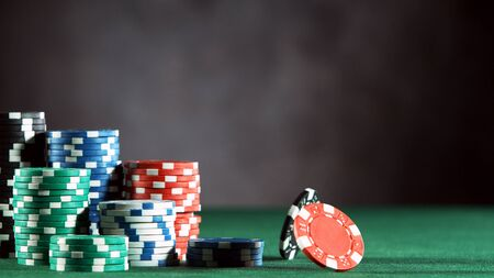 Poker still life with rotating poker chips . Concept of hazard gaming, free space for text.