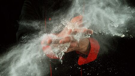 Freeze motion of cooker with clapping hands with flour. Food preparation concept. 写真素材