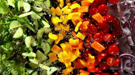 Freeze motion of flying fresh vegetable mix, isolated on black background