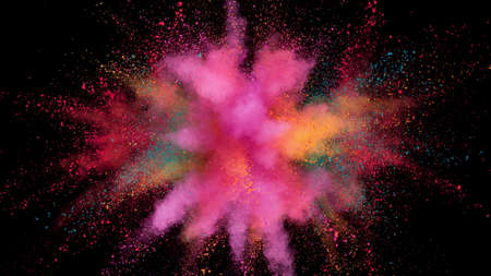 Colorful powder explosion isolated on black background, abstract background