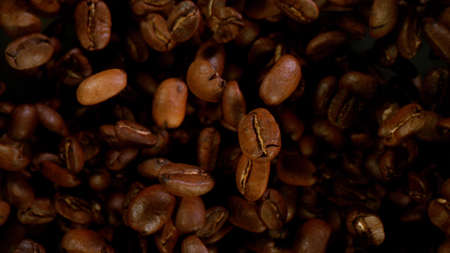 Cocoa beans flying in the air in freeze motion isolated on black background 스톡 콘텐츠