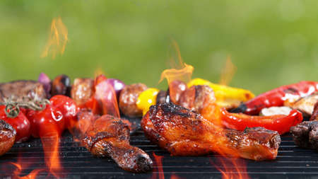 Assorted delicious grilled fish meat with vegetables. Outdoor grill barbecue mix.