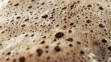 Freeze motion of macro shot of coffee drop beign fall into cup. Ultra detail. 스톡 콘텐츠