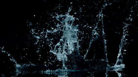 Abstract water splashes isolated on black background, freeze motion.