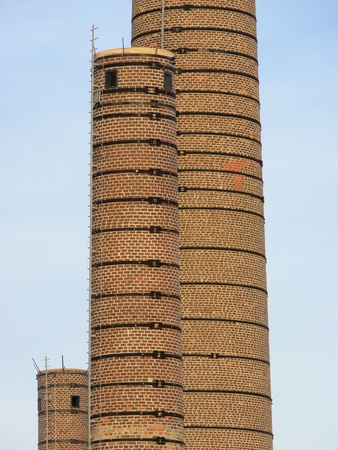 brick chimney in a factory photo