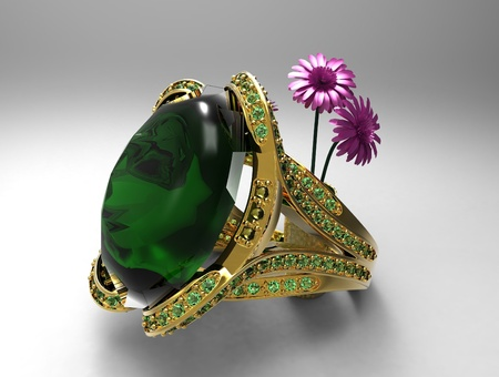 emerald ring and flowers Stock Photo