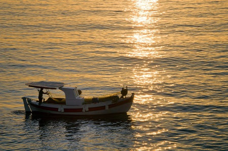 fish boat on the sea in the morning photo