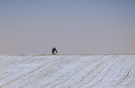 the cyclist in the snow photo