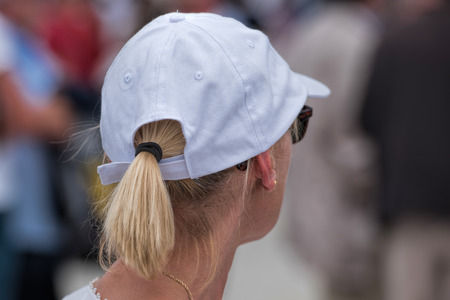 ponytail: woman with hat and ponytail Stock Photo