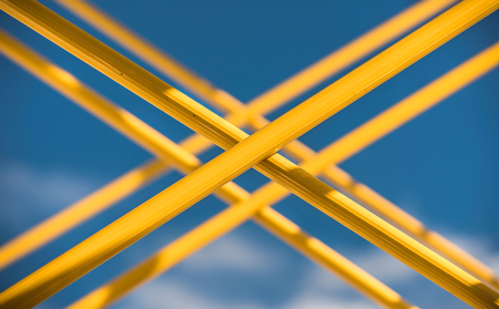 steel pipes: Yellow steel pipes crossed