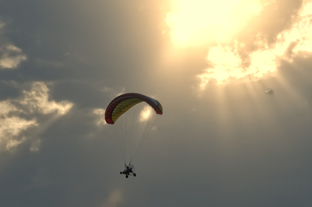Paragliding and sun