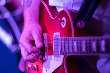 the guitarist in concert
