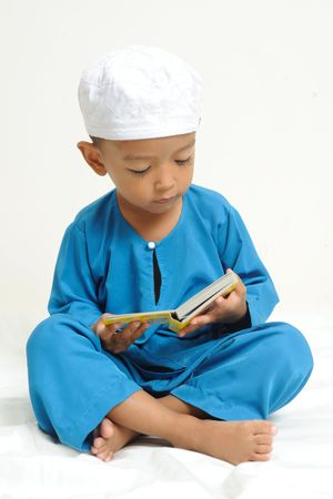 were: Islamic children  were learning with colorful book
