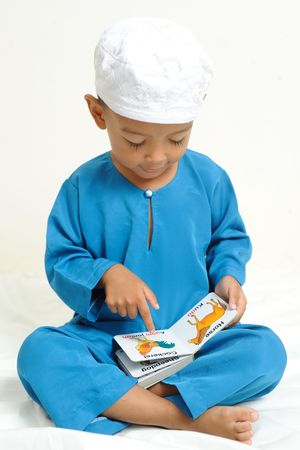 Islamic children  were learning with colorful book