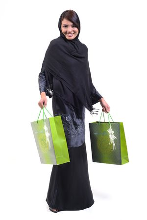 arab girl: woman carrying green shopping bags