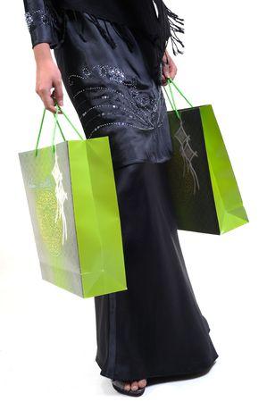 woman carrying green shopping bags