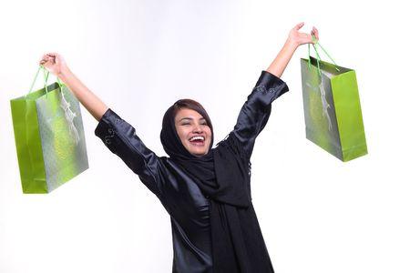 woman carrying green shopping bags Stock Photo - 5507494