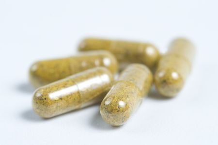 herbal pills on white background