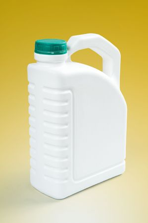 White plastic canister yellow background photo