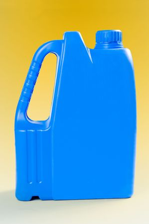 Blue plastic canister on yellow background photo