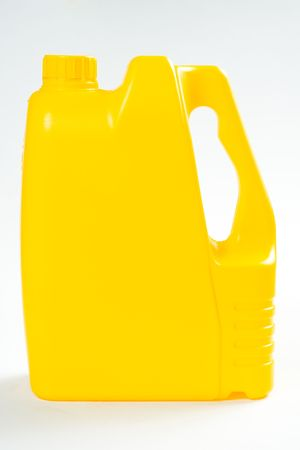Yellow plastic canister on white background photo