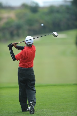 Golfer tees off on the Green photo