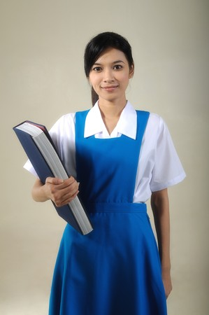 highschool: Portrait of Asian High school girl student with holding book Stock Photo