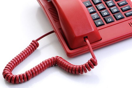 red telephone receiver on white background  photo