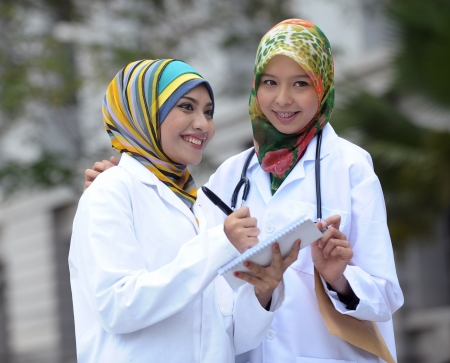 Two Women Doctor With Scarf, Outdoor photo