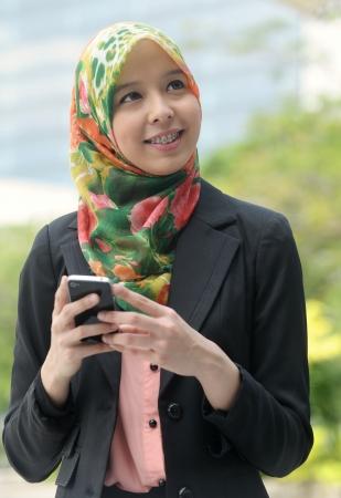 Scarf girl use smart phone photo