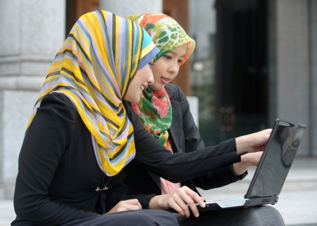 Two Scarf girl use laptop photo