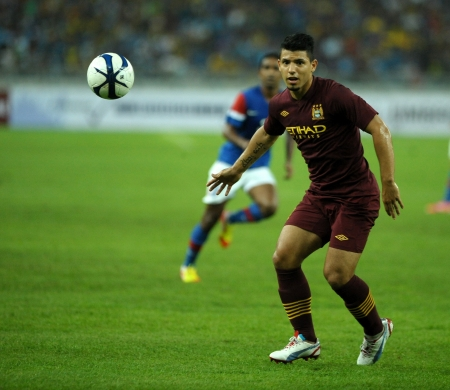 KUALA LUMPUR - JULY 30   Sergio Aguero run the ball during Manchester City friendly match against Malaysia at National Stadium, Kuala Lumpur in July 30, 2012  Manchester City won 3-1