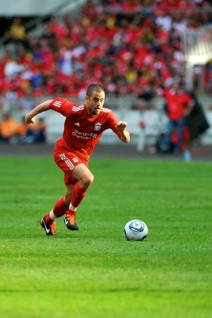 KUALA LUMPUR - JULY 16 : Liverpool player Joe Cole during a friendly match against Malaysia on July 16, 2011 in Kuala Lumpur, Malaysia. Liverpool won 6-3. 報道画像