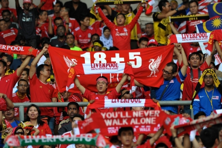 KUALA LUMPUR - JULY 16 : Liverpool football club fans during a friendly match against Malaysia XI on July 16, 2011 in Kuala Lumpur, Malaysia. Liverpool won 6-3.
