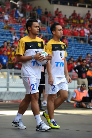KUALA LUMPUR - JULY 16 : Malaysia player Aidil and Norshahrul during a friendly match against Malaysia on July 16, 2011 in Kuala Lumpur, Malaysia. Liverpool won 6-3.